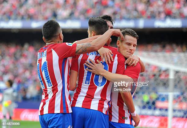 Yannick Carrasco of Club Atletico de Madrid celebrates with Kevin Gameiro after scoring his team's opning goal during the La Liga match between Club...