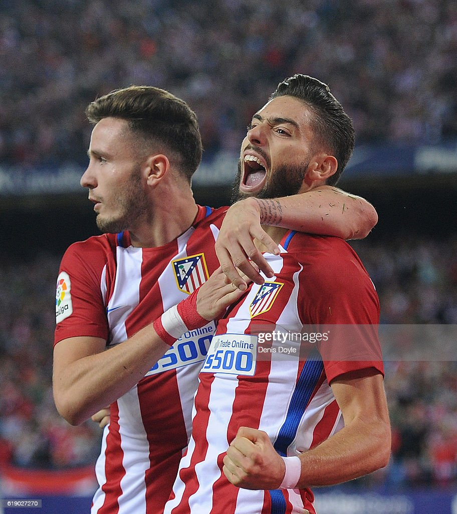 Yannick Carrasco of Club Atletico de Madrid celebrates with Saul Niguez after scoring his team's 4th goal during the La Liga match between Club Atletico de Madrid and Malaga CF at estadio Vicente Calderon on October 29, 2016 in Madrid, Spain.