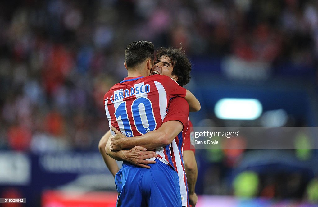 Yannick Carrasco of Club Atletico de Madrid celebrates with Tiago Mendes after scoring his team's 4th goal during the La Liga match between Club Atletico de Madrid and Malaga CF at estadio Vicente Calderon on October 29, 2016 in Madrid, Spain.