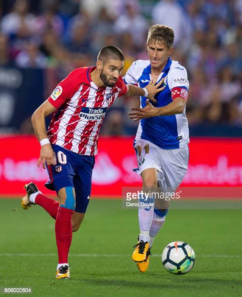Yannick Carrasco of Club Atletico de Madrid fends off Alexander Szymanowski of CD Leganes during the La Liga match between Leganes and Atletico...