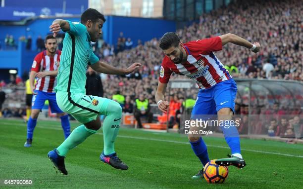 Yannick Carrasco of Club Atletico de Madrid in action against Rafinha Alcantara of FC Barcelona during the La Liga match between Club Atletico de...