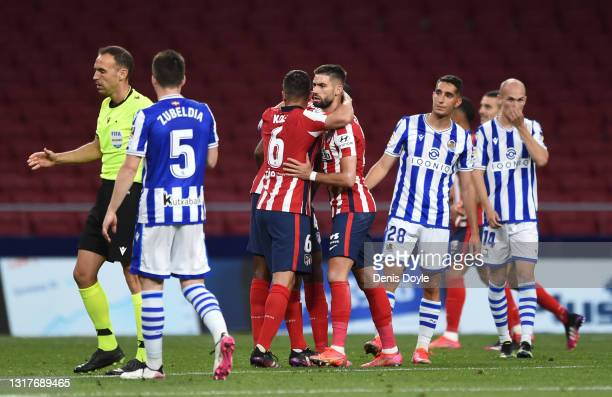 Yannick Ferreira Carrasco celebrates with Koke of Atletico Madrid during the La Liga Santander match between Atletico de Madrid and Real Sociedad at...