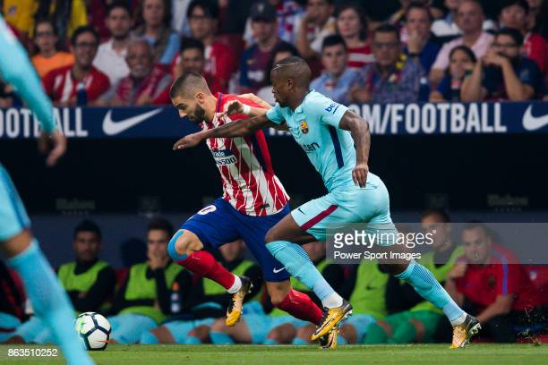 Yannick Ferreira Carrasco of Atletico de Madrid battles for the ball with Nelson Cabral Semedo of FC Barcelona during the La Liga 201718 match...