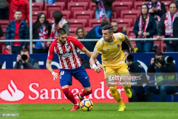 Yannick Ferreira Carrasco of Atletico de Madrid battles for the ball with Francisco Aday Benitez of Girona FC during the La Liga 201718 match between...