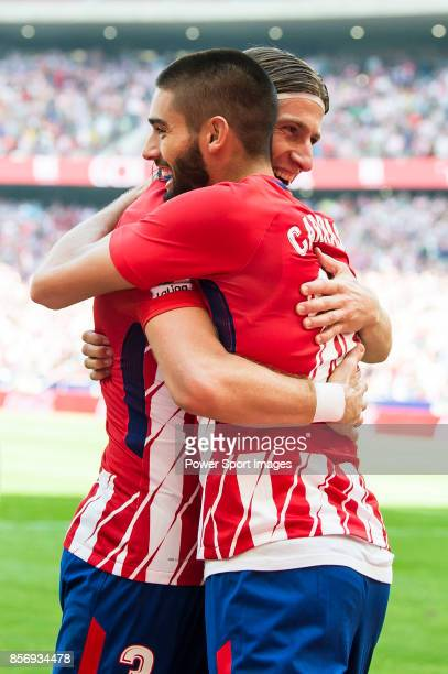 Yannick Ferreira Carrasco of Atletico de Madrid celebrates with teammate Filipe Luis during the La Liga 201718 match between Atletico de Madrid and...