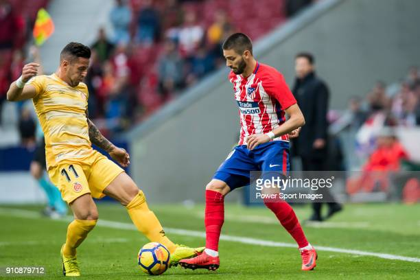 Yannick Ferreira Carrasco of Atletico de Madrid competes for the ball with Francisco Aday Benitez of Girona FC during the La Liga 201718 match...