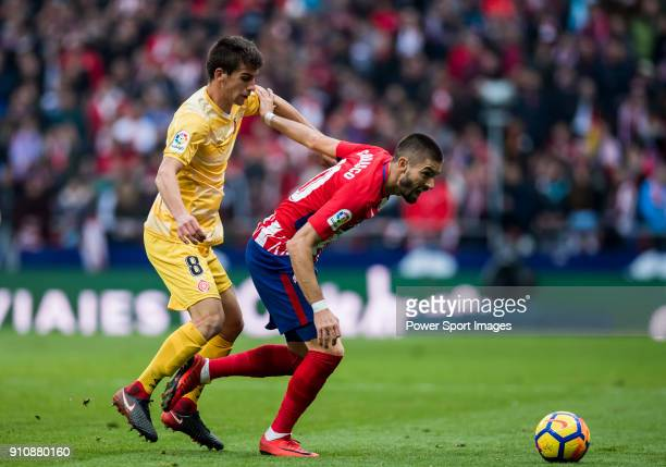 Yannick Ferreira Carrasco of Atletico de Madrid competes for the ball with Pere Pons Riera of Girona FC during the La Liga 201718 match between...