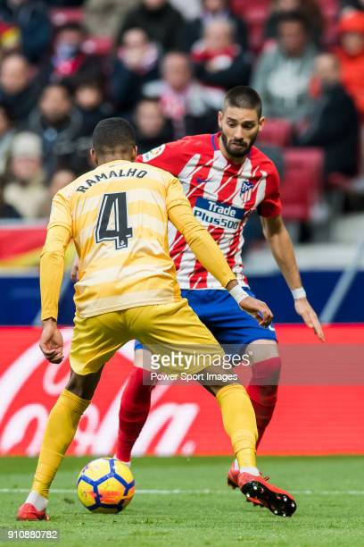 Yannick Ferreira Carrasco of Atletico de Madrid competes for the ball with Jonas Ramalho Chimeno of Girona FC during the La Liga 201718 match between...