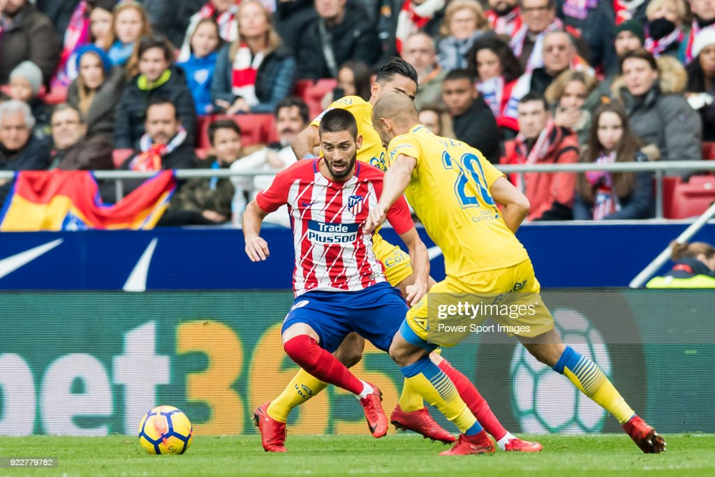 Yannick Ferreira Carrasco (L) of Atletico de Madrid competes for the ball with Alejandro Galvez Jimena (R) and David Simon of UD Las Palmas during the La Liga 2017-18 match between Atletico de Madrid and UD Las Palmas at Wanda Metropolitano on January 28 2018 in Madrid, Spain.