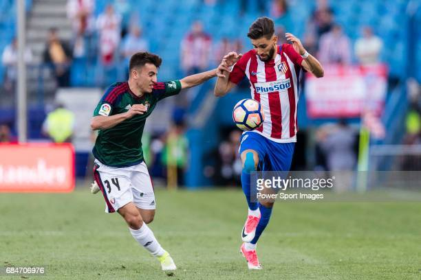 Yannick Ferreira Carrasco of Atletico de Madrid fights for the ball with Aitor Bunuel Redrado of Osasuna during the La Liga match between Atletico de...
