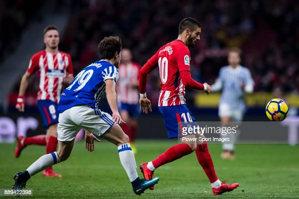 Yannick Ferreira Carrasco of Atletico de Madrid fights for the ball with Alvaro Odriozola Arzallus of Real Sociedad during the La Liga 201718 match...