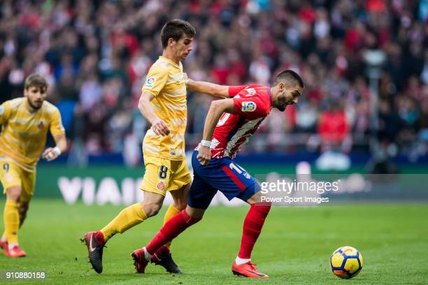 Yannick Ferreira Carrasco of Atletico de Madrid fights for the ball with Pere Pons Riera of Girona FC during the La Liga 201718 match between...