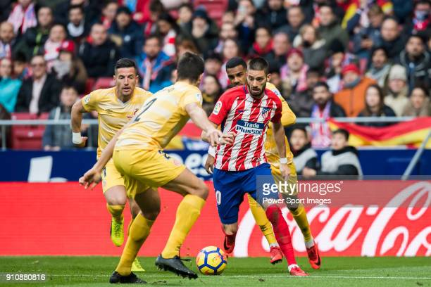 Yannick Ferreira Carrasco of Atletico de Madrid fights for the ball with players of Girona FC during the La Liga 201718 match between Atletico de...