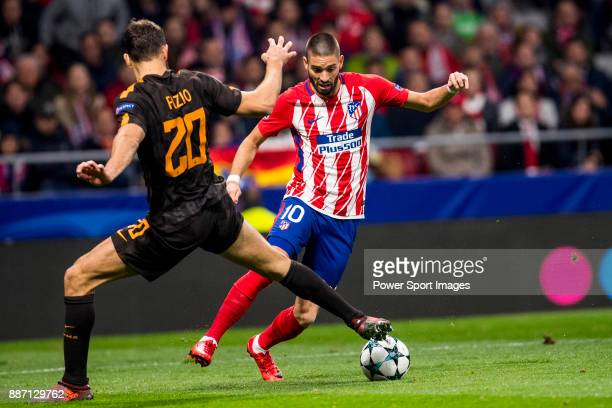 Yannick Ferreira Carrasco of Atletico de Madrid flights the ball with Federico Fazio of AS Roma during the UEFA Champions League 201718 match between...