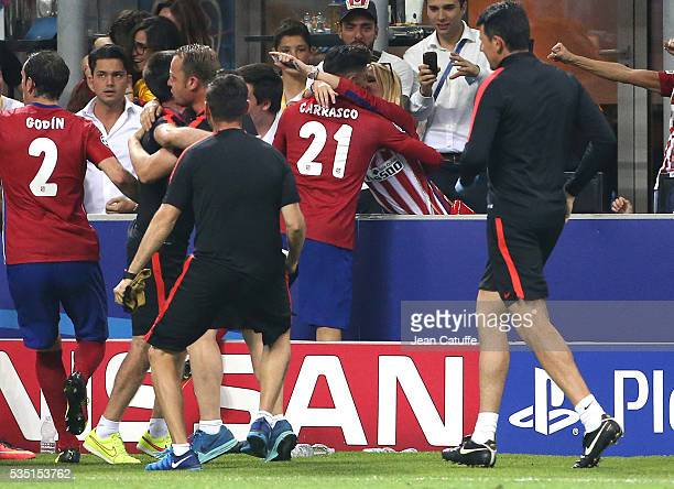 Yannick Ferreira Carrasco of Atletico Madrid celebrates his goal by kissing his girlfriend Noemie Happart during the UEFA Champions League final...