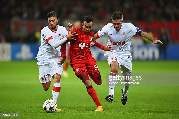 Yannick Ferreira Carrasco of Monaco Karim Bellarabi of Bayer Leverkusen and Jeremy Toulalan of Monaco battle for the ball during the UEFA Champions...