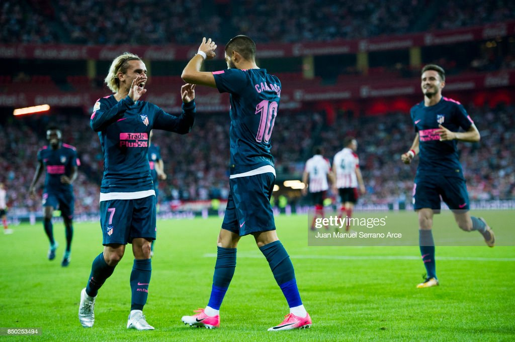 Yannick Ferreira-Carrasco of Atletico Madrid celebrates with his teammates Antoine Griezmann of Atletico Madrid after scoring his team's second goal during the La Liga match between Athletic Club Bilbao and Atletico Madrid at San Mames Stadium on September 20, 2017 in Bilbao, Spain.