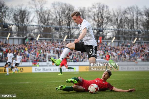 Yannick Gerhardt of Germany and Fernando Fonseca of Portugal battle for the ball during the U21 International Friendly match between Germany U21 and...