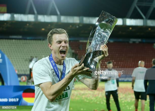 Yannick Gerhardt of Germany celebrates with the trophy after the UEFA U21 Final match between Germany and Spain at Krakow Stadium on June 30 2017 in...