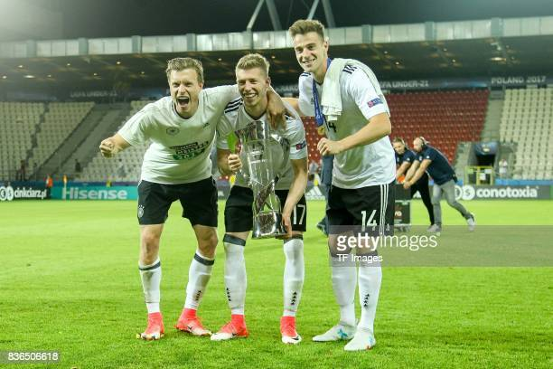 Yannick Gerhardt of Germany Mitchell Weiser of Germany and Lukas Kluenter of Germany celebrates with the trophy after the UEFA U21 Final match...
