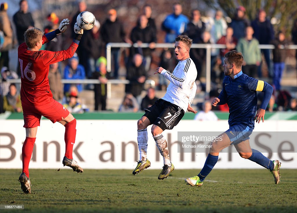 Yannick Gerhardt (middle) of Germany with good chance against Paul Nardi (l) and Lucas Rogeaux during the International Friendly match between U19 Germany and U19 France at Rheinstadium on November 14, 2012 in Kehl, Germany.