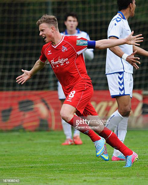 Yannick Gerhardt of Koeln celebrates his team's first goal during the DFB Juniors Cup Semi Final between Karlsruher SC and 1 FC Koeln on May 1 2013...