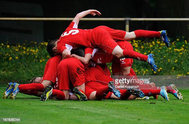 Yannick Gerhardt of Koeln celebrates his team's first goal with team mates during the DFB Juniors Cup Semi Final between Karlsruher SC and 1 FC Koeln...