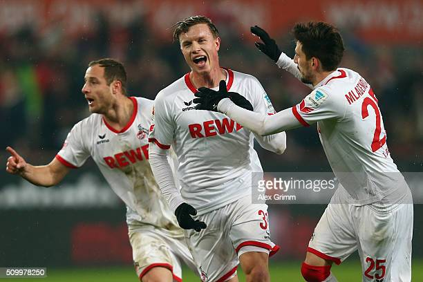 Yannick Gerhardt of Koeln celebrates his team's first goal with team mates Matthias Lehmann and Filip Mladenovic during the Bundesliga match between...