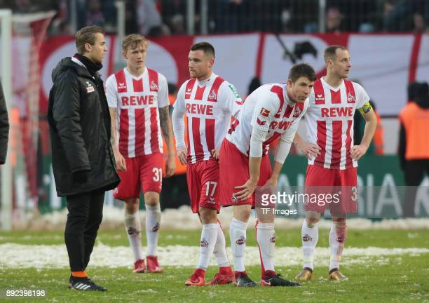 Yannick Gerhardt of Koeln Christian Clemens of Koeln Dominique Heintz of Koeln and Matthias Lehmann of Koeln look dejected after the Bundesliga match...
