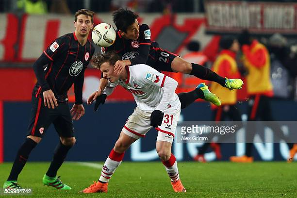 Yannick Gerhardt of Koeln is challenged by Makoto Hasebe of Frankfurt during the Bundesliga match between 1. FC Koeln and Eintracht Frankfurt at...