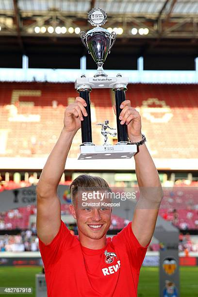 Yannick Gerhardt of Koeln lifts the trophy for the best valuable player after winning the Colonia Cup 2015 with his team at RheinEnergieStadion on...