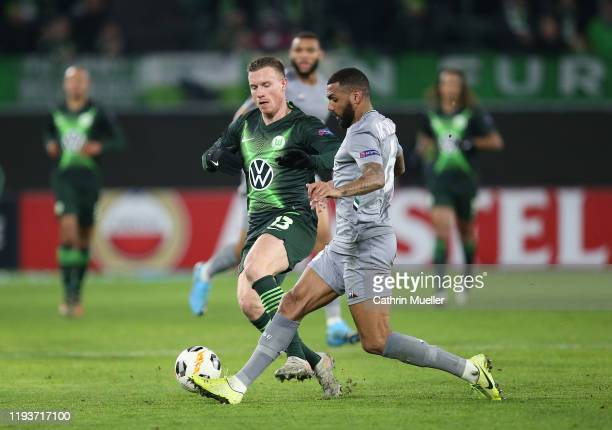 Yannick Gerhardt of VfL Wolfsburg and Yann M Vila of AS Saint-Etienne battle for the ball during the UEFA Europa League group I match between VfL...