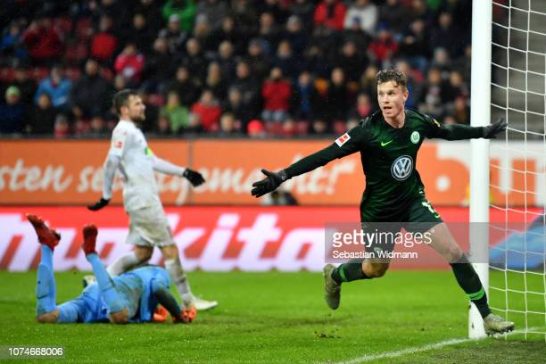 Yannick Gerhardt of VfL Wolfsburg celebrates after scoring his sides third goal during the Bundesliga match between FC Augsburg and VfL Wolfsburg at...