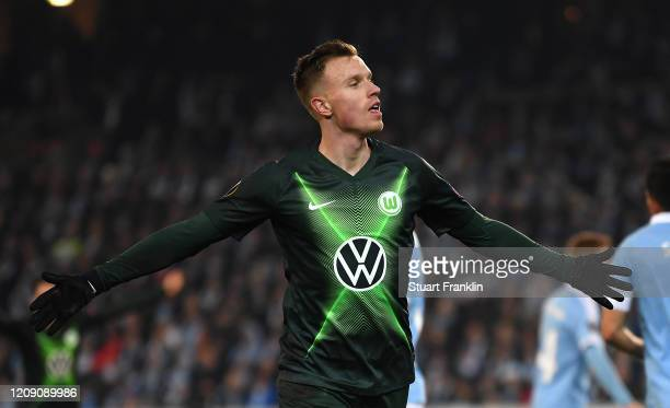 Yannick Gerhardt of VfL Wolfsburg celebrates after scoring his team's second goal during the UEFA Europa League round of 32 second leg match between...