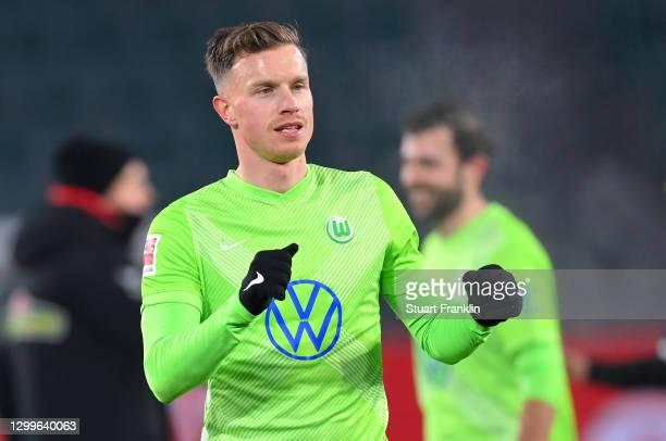 Yannick Gerhardt of VfL Wolfsburg celebrates victory following the Bundesliga match between VfL Wolfsburg and Sport-Club Freiburg at Volkswagen Arena...