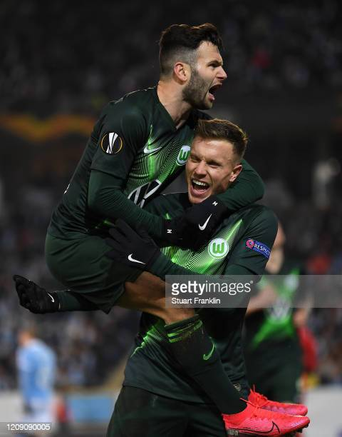 Yannick Gerhardt of VfL Wolfsburg celebrates with Renato Steffen after scoring his team's second goal during the UEFA Europa League round of 32...