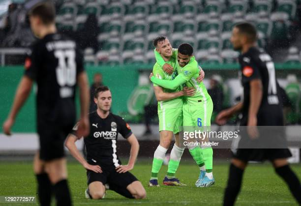 Yannick Gerhardt of Vfl Wolfsburg celebrates with team mate Paulo Otavio Rosa Silva after scoring their sides first goal during the DFB Cup second...