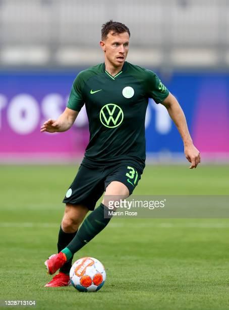 Yannick Gerhardt of VfL Wolfsburg runs with the ball during a pre-season friendly match between VfL Wolfsburg and Holstein Kiel at AOK-Stadion on...