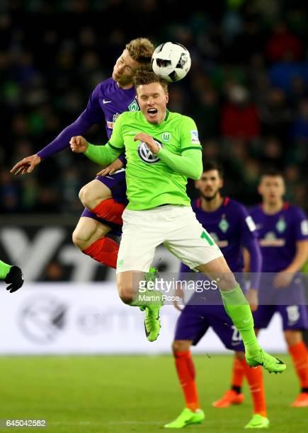 Yannick Gerhardt of Wolfsburg and Florian Kainz of Bremen jump to head for the ball during the Bundesliga match between VfL Wolfsburg and Werder...