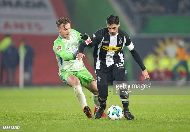 Yannick Gerhardt of Wolfsburg and Lars Stindl of Borussia Moenchengladbach battle for the ball during the Bundesliga match between VfL Wolfsburg and...