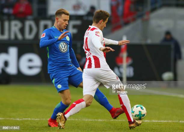Yannick Gerhardt of Wolfsburg and Lukas Kluenter of Koeln battle for the ball during the Bundesliga match between 1 FC Koeln and VfL Wolfsburg at...