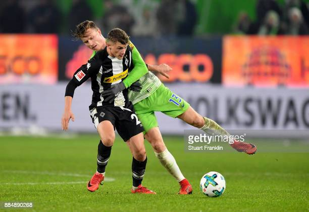 Yannick Gerhardt of Wolfsburg and Mickael Cuisance of Moenchengladbach battle for the ball during the Bundesliga match between VfL Wolfsburg and...