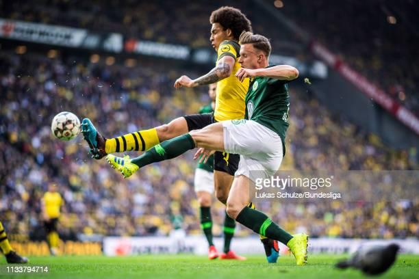 Yannick Gerhardt of Wolfsburg in action against Axel Witsel of Dortmund during the Bundesliga match between Borussia Dortmund and VfL Wolfsburg at...