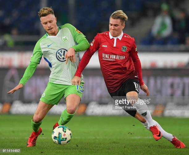 Yannick Gerhardt of Wolfsburg is challenged by Felix Klaus of Hannover during the Bundesliga match between Hannover 96 and VfL Wolfsburg at HDIArena...