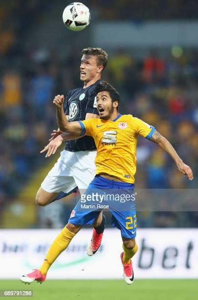 Yannick Gerhardt of Wolfsburg jumps for a header with Salim Khelifi of Braunschweig during the Bundesliga Playoff leg 2 match between Eintracht...