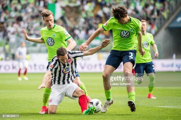 Yannick Gerhardt of Wolfsburg Varela Guillermo of Frankfurt and Philipp Wollscheid of Wolfsburg fight for the ball during the Bundesliga match...