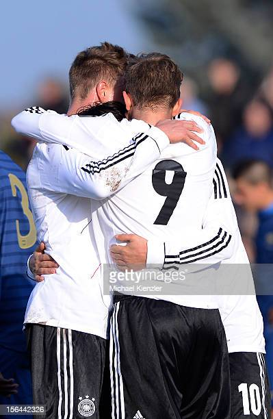 Yannick Gerhardt Patrick Weihrauch and Fabian Schnellhardt of Germany celebrate the opening goal during the International Friendly match between U19...