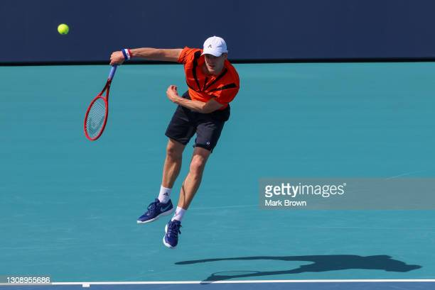 Yannick Hanfmann of Germany serves during his men's singles first round match against Steve Johnson of the United States on Day 3 of the 2021 Miami...