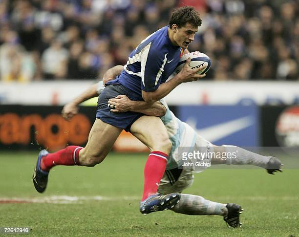 Yannick Jauzion of France is tackled during the international rugby game between France and Argentina on November 25 2006 at Stade De France Stadium...