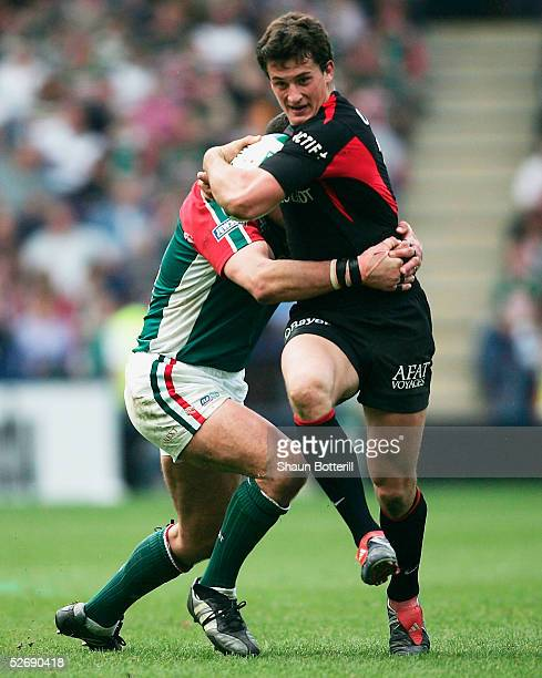 Yannick Jauzion of Toulouse is tackled by Martin Johnson of Leicester during the Heineken Cup Semi Final match between Leicester Tigers and Toulouse...